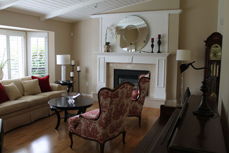Sitting room with redesigned fireplace and furnishings